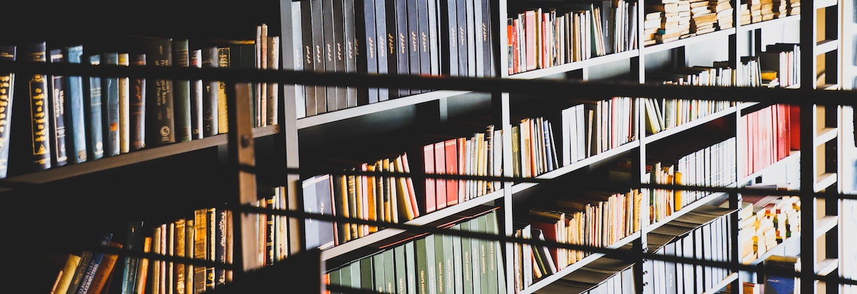 Books in a library for original economic research, investments, health, and more.