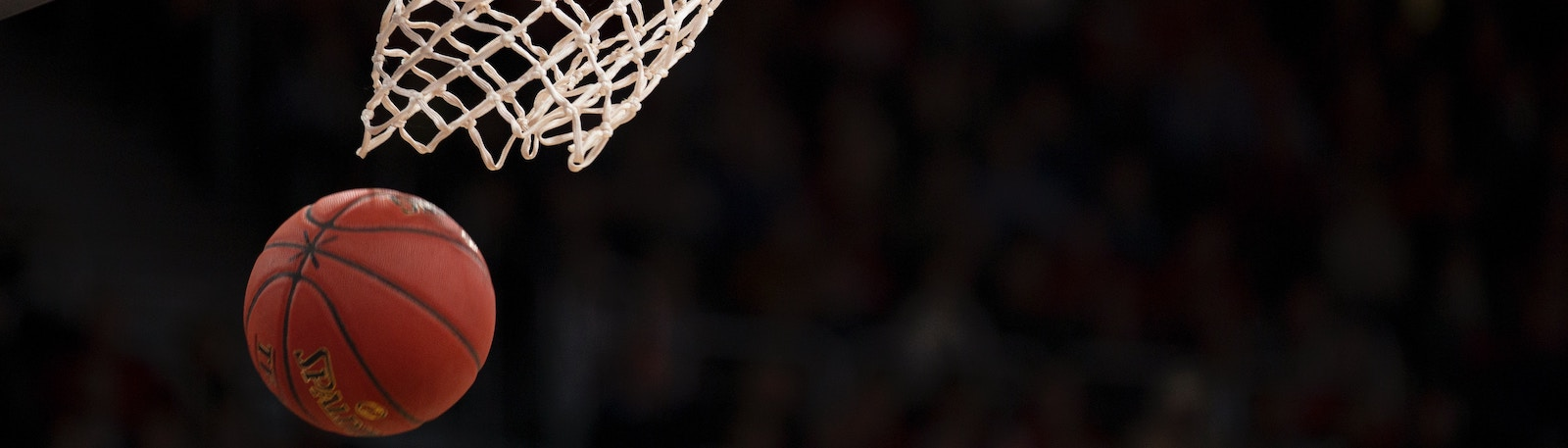 Basketball swishing through a net