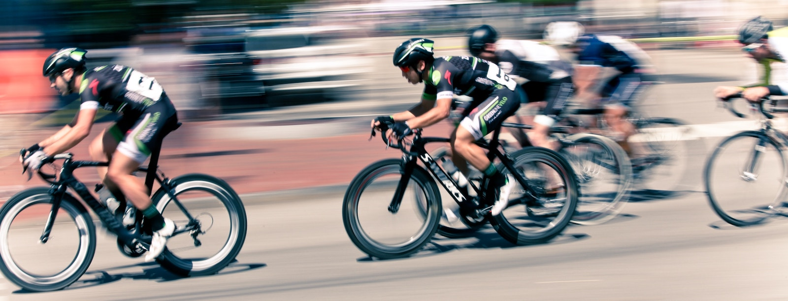 Athletic bikers participating in a road race.