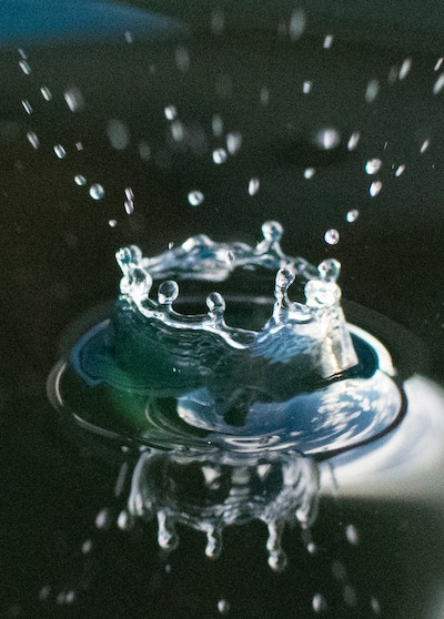 Drop of water in a lake with tiny droplets.