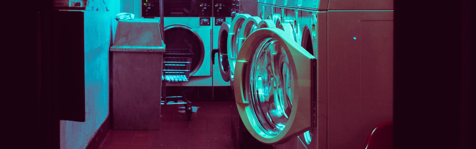Picture of washing machines open in a laundromat.