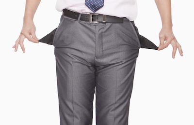 Businessman exposing empty pockets showing low savings